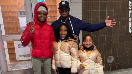 Emmanuel Cooper with his grandkids, Stephanie, Savannah and Kalieah.