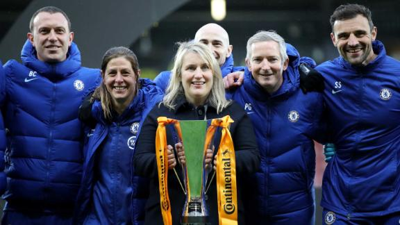 WATFORD, ENGLAND - MARCH 14: Emma Hayes, Head Coach of Chelsea Women's celebrates with the trophy and her backroom staff after her teams victory during the FA Women's Continental Tyres League Cup Final match between Bristol City Women and Chelsea Women at Vicarage Road on March 14, 2021 in Watford, England. Sporting stadiums around the UK remain under strict restrictions due to the Coronavirus Pandemic as Government social distancing laws prohibit fans inside venues resulting in games being played behind closed doors. (Photo by Naomi Baker/Getty Images)