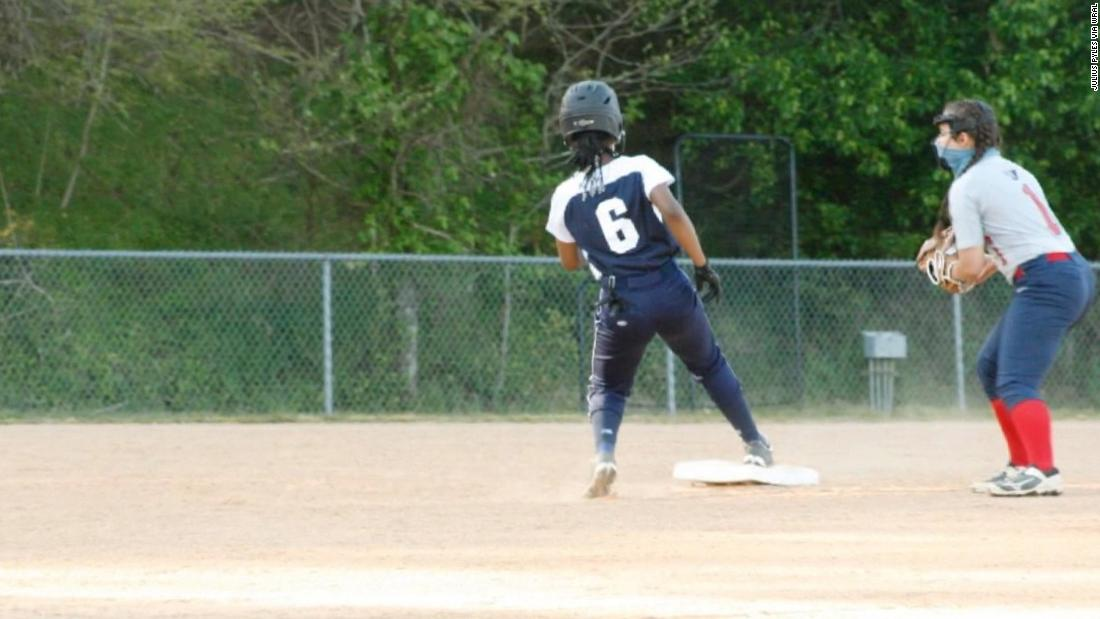 A Black softball player says she was forced to cut off her hair beads at a game
