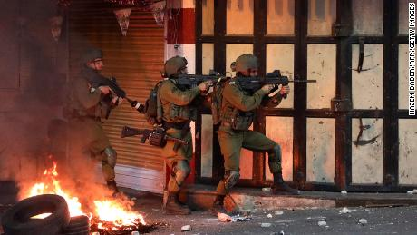 Israeli soldiers operate during clashes with Palestinian protesters in the city of Hebron, West Bank, on May 14.