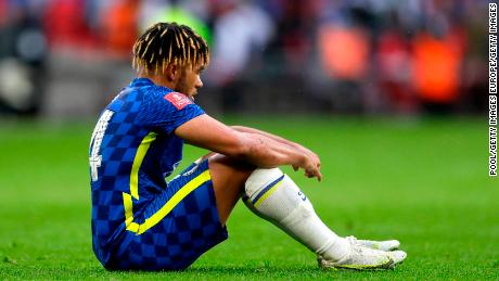 Reece James sits downcast on the pitch after Chelsea's defeat in Saturday's FA Cup final.