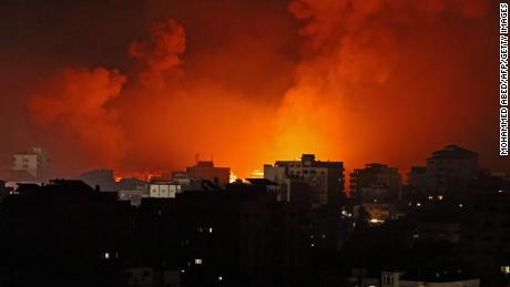 Smoke billows from a fire following multiple Israeli airstrikes in Gaza on May 16.