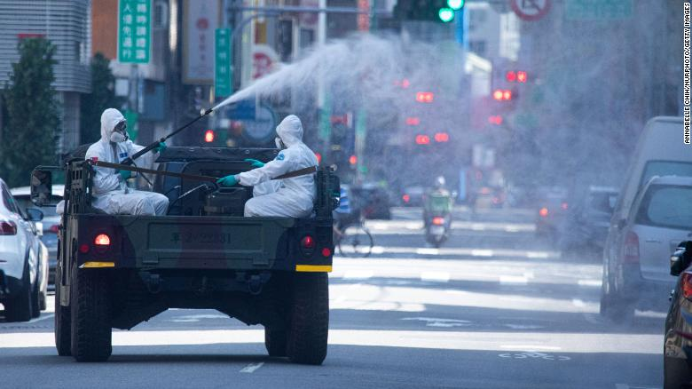Disinfectant is sprayed on the street in Wanhua District, Taipei, Taiwan on May 16, 2021.