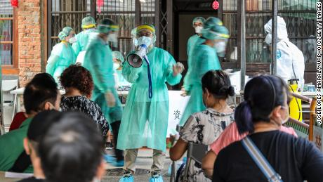 Medical staff giving information at a Covid-19 screening station in Taipei City
