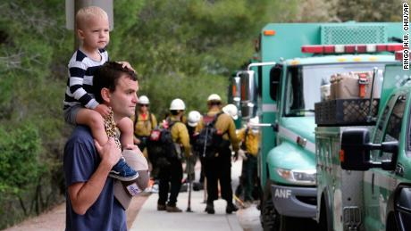 Mike Sutton, who lives in Pacific Palisades, 31, and his 2-year-old son Tommy watched the deployment of firefighters on Sunday.
