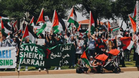 A large crowd marches in Dallas on Saturday, May 15.