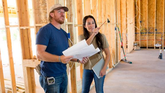 Joanna Gaines visiting husband Chip to check in on the progression of the Pahmiyer home, as seen on Fixer Upper. Joanna points out where is she wanting to put a fireplace.