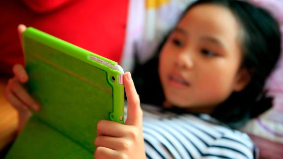 Girl playing with her tablet during a Pokemon Go gaming. | usage worldwide Photo by: Fred de Noyelle / Godong/picture-alliance/dpa/AP Images