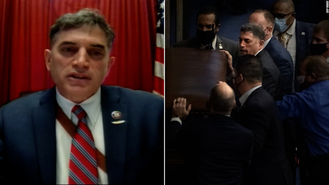 Photo shows Rep. Clyde barricading door during insurrection