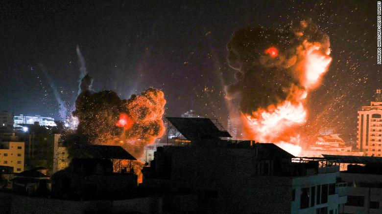 Explosions are seen in Gaza City as Israeli forces target the Palestinian enclave with airstrikes early Tuesday.