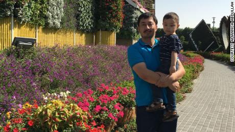 Amannisa Abdullah's husband Ahmad Talip and their son, Musa, in Dubai.