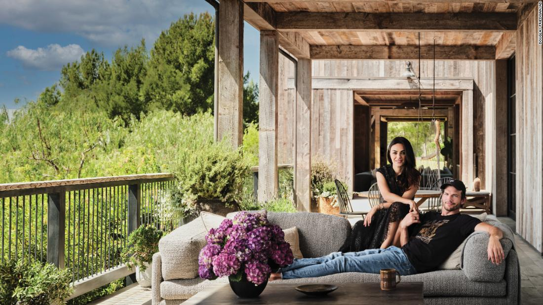 Mila Kunis and Ashton Kutcher open the doors to their stunning barn-inspired home