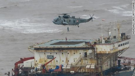 Stranded workers are airlifted by the Indian Navy from a barge in the Arabian Sea, which had gone adrift during Cyclone Tauktae, on May 18.