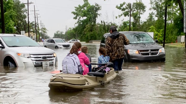 Flash flood warnings and tornado watches issued for Texas counties as more than 100,000 are without power