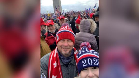 Screenshot of a photo of Mark and Jalise Middleton with the Washington Monument behind them, which Jalise posted on Facebook, from Justice Department court documents.
