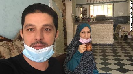 Musa Abu Askar, left, and Rasha Abu Askar in their home in Gaza. Both tested positive for the coronavirus just before violence flared.