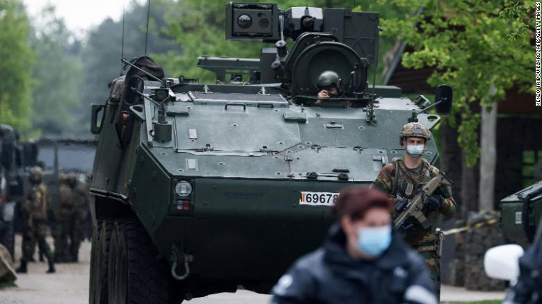 Police hunt for man who had rocket launcher and threatened Belgium's top virologist