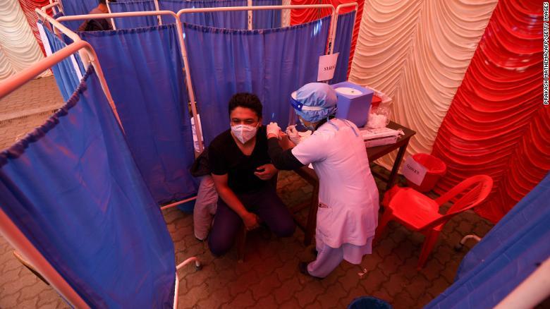 A health worker receives a dose of Covishield, AstraZeneca-Oxford's Covid-19 coronavirus vaccine made by Serum Institute of India, at Patan Hospital near Kathmandu on January 27, 2021.