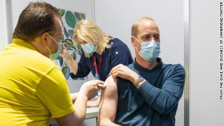 Prince William is pictured getting a Covid-19 vaccine dose in London this week.