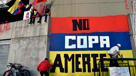 Street artists protest against Colombia being the host of Copa America on a wall of a stadium in May.