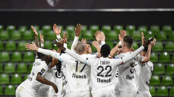 TOPSHOT - Lille's players celebrate after scoring a goal during the French L1 football match between Metz (FC Metz) and Lille (LOSC) at Saint Symphorien stadium in Longeville-les-Metz, eastern France, on April 9, 2021. (Photo by JEAN-CHRISTOPHE VERHAEGEN / AFP) (Photo by JEAN-CHRISTOPHE VERHAEGEN/AFP via Getty Images)