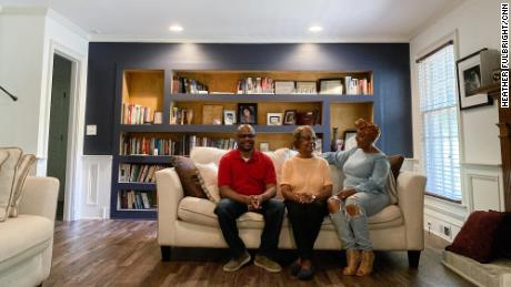 Dawn Moore-Johnson, right, and her husband, Anthony Johnson, sit with her mother, Delores Moore, who moved into their home during the pandemic.