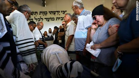 Mourners attend the funeral of Yigal Yehoshua on Tuesday.