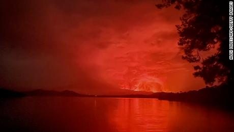 A view from Tchegera Island on Lake Kivu in the Democratic Republic of Congo shows flame spewing from Mount Nyiragongo on Saturday, May 22.