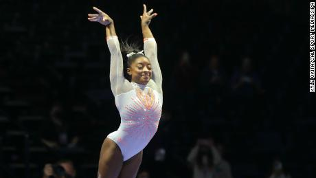 Simone Biles becomes the first woman to land a Yurchenko double pike during competition at the 2021 GK US Classic in Indianapolis, Indiana on Saturday.