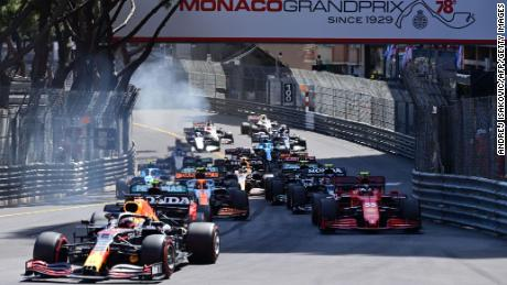 Verstappen, left, Sainz, right, and other drivers compete during the Monaco Grand Prix.