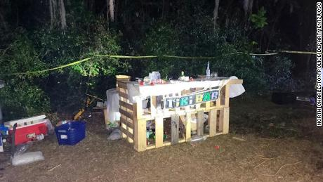 """Images of the scene in North Charleston, taken by police and provided by CNN affiliate WCSC show a makeshift """"tiki bar,"""" coolers and drinks scattered across the area, a stage with large speakers."""