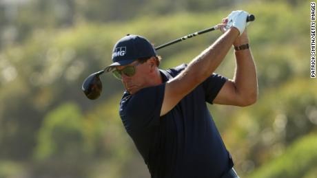 Mickelson plays his shot from the 12th tee during the final round.