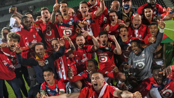 Lille's players celebrate after winning the Ligue 1 title.