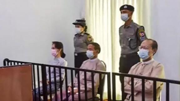 Aung San Suu Kyi appears in court in Naypyidaw on May 24 for the first time since the military detained her in a February coup.
