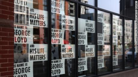 Signs remembering George Floyd are displayed outside a store in Minneapolis on Sept. 19, 2020.
