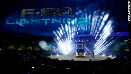 Ford Chief Engineer Linda Zhang unveils the Ford F-150 Lightning in Dearborn, Michigan.  On the outside, the electric version of Ford's F-150 pickup looks pretty much the hugely popular gasoline truck.