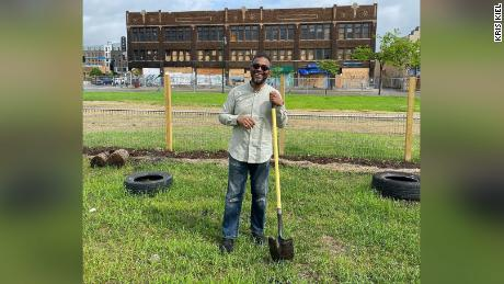 Restaurateur Ruhel Islam stands in an empty lot at 3009 27th Ave. S. in Minneapolis where he plans to rebuild his Gandhi Mahal restaurant, which was destroyed during riots over the police murder of George Floyd a year ago.