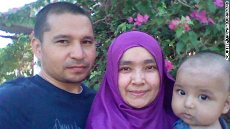 Maryam Muhammad, her child and her husband, Muhtar Rozi, who disappeared during a crackdown on Uyghur Muslims in Egypt.
