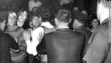 A crowd attempts to impede police arrests outside the Stonewall Inn on Christopher Street in Greenwich Village.