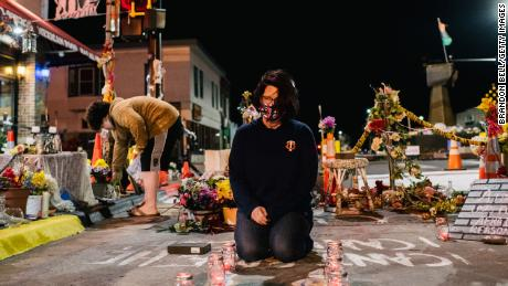 Courteney Ross, girlfriend of George Floyd, lays candles in the intersection of 38th St. & Chicago Ave on March 29, 2021 in Minneapolis, Minnesota.