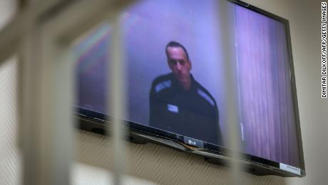 Jailed Kremlin critic Alexey Navalny appears on screen via a video link from prison during a court hearing in the town of Petushki some 75 miles outside Moscow in May.