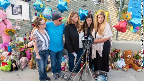 Family members of 6-year-old Aiden Leos stand at a makeshift memorial on Tuesday. Pictured are, from left, Cherrie Cloonan, John Cloonan, Carole Ybanez, Alexis Cloonan and Carly Lacy.