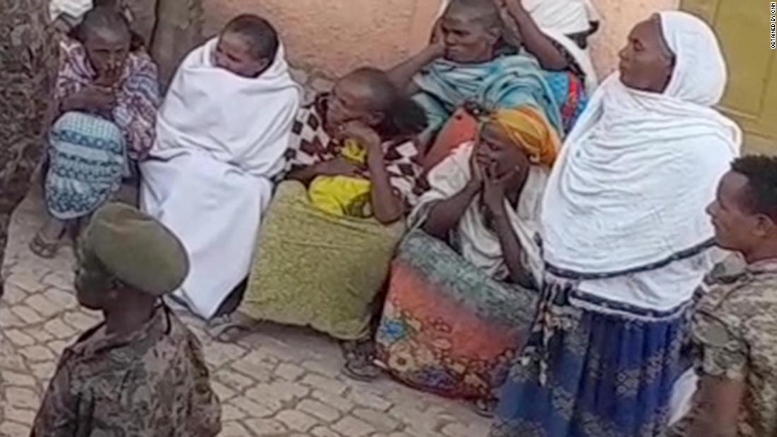 A screenshot from video obtained by CNN shows Ethiopian soldiers addressing families inside the UNHCR compound awaiting word of their loved ones.