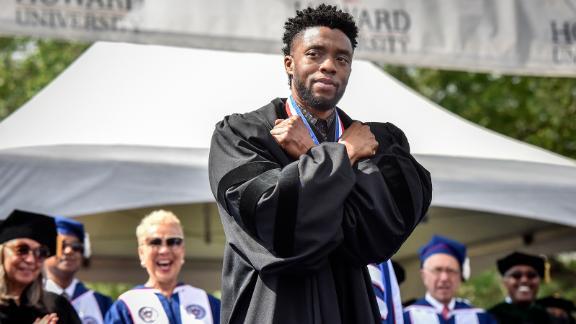 Boseman gives a Wakanda salute during his commencement speech at Howard University on May 12, 2018.