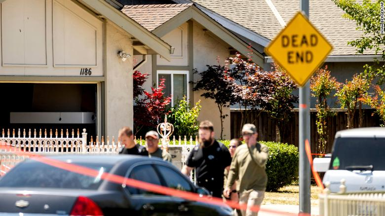 Emergency responders leave a home, rear, being investigated in connection to the shooting on Wednesday in San Jose.