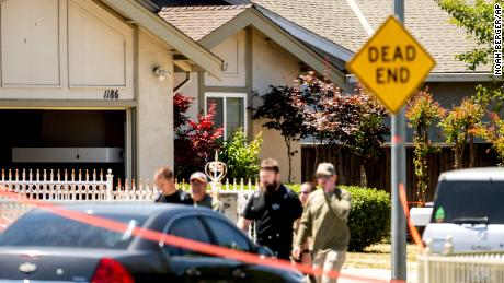 Emergency responders leave a house in the back being investigated in connection with a shooting in San Jose, California.