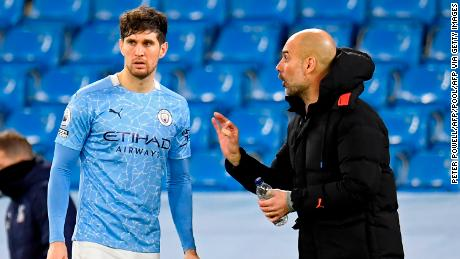 """John Stones says Pep Guardiola is """"100%"""" one of the greats."""