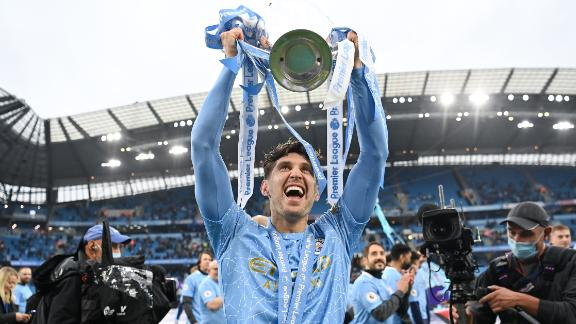 MANCHESTER, ENGLAND - MAY 23: John Stones celebrates with the Premier League Trophy as Manchester City are presented with the Trophy as they win the league following the Premier League match between Manchester City and Everton at Etihad Stadium on May 23, 2021 in Manchester, England. A limited number of fans will be allowed into Premier League stadiums as Coronavirus restrictions begin to ease in the UK. (Photo by Michael Regan/Getty Images)