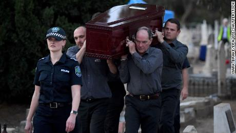 Adelaide Cemetery Authority pall bearers carry the body of the exhumed Somerton Man on May 19, 2021.