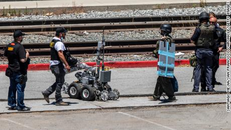Santa Clara County Sheriff's Department deploy a robot at the parking lot of the VTA Light Rail Facility, Wednesday, May 26, 2021, in San Jose, California.